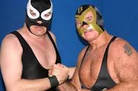 AWA Coastal champion The Nighthawk and WWE Hall of Fame member Bullet Bob Armstrong have a reunion at an AWA card in Florida in 2006.